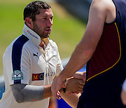 Tim T Bresnan, Team Captain (Yorkshire CCC) shakes hands with Team Captain of Durham CCC, Paul Collingwood on his way back to the pavilion, after winning the match against Durham County Cricket Club in the LV County Championship Div 1 match between Durham County Cricket Club and Yorkshire County Cricket Club at the Emirates Durham ICG Ground, Chester-le-Street, United Kingdom on 1 July 2015. Photo by George Ledger.