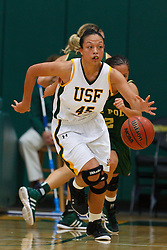Nov 16, 2011; San Francisco CA, USA;  San Francisco Lady Dons guard Mel Khlok (45) dribbles the ball up court against the Cal Poly Mustangs during the second half at War Memorial Gym.  Cal Poly defeated San Francisco 80-66. Mandatory Credit: Jason O. Watson-US PRESSWIRE