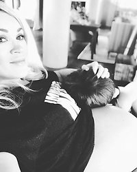 """Carrie Underwood releases a photo on Instagram with the following caption: """"Kicking off 2019 right...Me and my boys cuddled up watching a movie. Yes, I\u2019m wearing Mike\u2019s shirt. \ud83d\ude2c #LettingItAllHangOut \ud83e\udd30"""". Photo Credit: Instagram *** No USA Distribution *** For Editorial Use Only *** Not to be Published in Books or Photo Books ***  Please note: Fees charged by the agency are for the agency's services only, and do not, nor are they intended to, convey to the user any ownership of Copyright or License in the material. The agency does not claim any ownership including but not limited to Copyright or License in the attached material. By publishing this material you expressly agree to indemnify and to hold the agency and its directors, shareholders and employees harmless from any loss, claims, damages, demands, expenses (including legal fees), or any causes of action or allegation against the agency arising out of or connected in any way with publication of the material."""