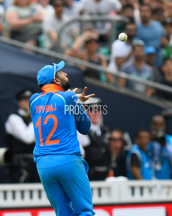 Wicket - Yuvraj Singh of India takes the catch to dismiss Babar Azam of Pakistan during the ICC Champions Trophy final match between Pakistan and India at the Oval, London, United Kingdom on 18 June 2017. Photo by Graham Hunt.017. Photo by Graham Hunt.