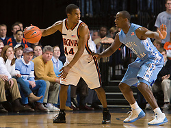 Virginia guard Sean Singletary (44) is guarded by North Carolina guard/forward Marcus Ginyard (1).  The Virginia Cavaliers men's basketball team faced the #3 ranked North Carolina Tar Heels  at the John Paul Jones Arena in Charlottesville, VA on February 12, 2008.