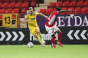 AFC Wimbledon midfielder Scott Wagstaff (7) taking on Charlton Athletic defender Kenneth Yao (41) during the EFL Trophy match between Charlton Athletic and AFC Wimbledon at The Valley, London, England on 4 September 2018.