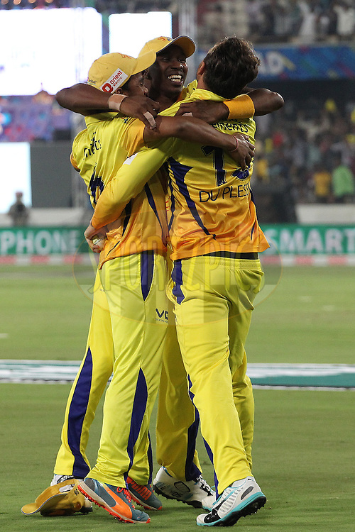 Dwayne BRAVO of the Chennai Superkings  and Pawan NEGI of the Chennai Superkings congratulate Francois Du PLESSIS of the Chennai Superkings on taking the catch to dismiss Manan VOHRA of the Kings XI Punjab  during the second semi final match of the Oppo Champions League Twenty20 between the Kings XI Punjab and the Chennai Superkings held at the Rajiv Gandhi Cricket Stadium, Hyderabad, India on the 2nd October 2014<br /> <br /> Photo by:  Ron Gaunt / Sportzpics/ CLT20<br /> <br /> <br /> Image use is subject to the terms and conditions as laid out by the BCCI/ CLT20.  The terms and conditions can be downloaded here:<br /> <br /> http://sportzpics.photoshelter.com/gallery/CLT20-Image-Terms-and-Conditions-2014/G0000IfNJn535VPU/C0000QhhKadWcjYs
