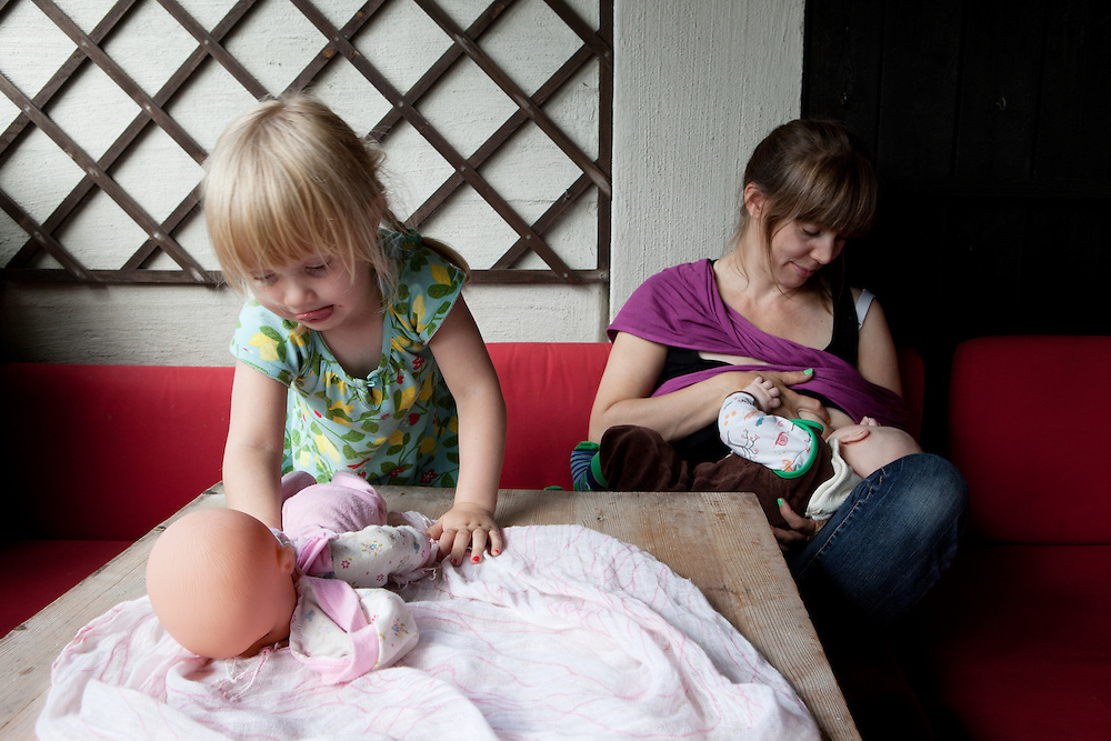 Oslo, Norway, August 25, 2012. Hanna, 36 years old with her two children Anna, 2 years old and Anton, 3 months old.
