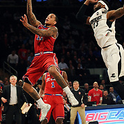 D'Angelo Harrison, St. John's, drive to the basket during the Providence Vs St. John's Red Storm basketball game during the Big East Conference Tournament at Madison Square Garden, New York, USA. 12th March 2014. Photo Tim Clayton