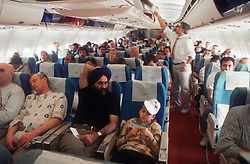 Passengers travelling on board a plane,