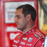 NASCAR Sprint Cup driver Juan Pablo Montoya (42) is seen in the garage area during the NASCAR Coke Zero 400 Sprint practice session at the Daytona International Speedway on Thursday, July 4, 2013 in Daytona Beach, Florida.  (AP Photo/Alex Menendez)