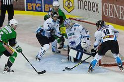 12.10.2012. Hala Tivoli, Ljubljana, SLO, EBEL, HDD Telemach Olimpija Ljubljana vs SAPA Fehérvár AV 19, 11. Runde, in picture Adam Munro, Juray Durco and Tamas Pozsgai (SAPA Fehérvár AV 19, #14,44, 51) vs Brock McBride, Andrew Thomas (HDD Telemach Olimpija, #5, 10) during the Erste Bank Ice hockey League 11th Round match between HDD Telemach Olimpija Ljubljana and SAPA Fehérvár AV 19 at the Hala Tivoli, Ljubljana, Slovenia on 2012/10/12. Telemach Olimpija Ljubljana defeated SAPA Fehérvár AV 19, 4-2 (Photo By Grega Valancic / Sportida)