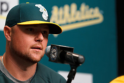 OAKLAND, CA - AUGUST 01:  Jon Lester #31 of the Oakland Athletics speaks during a press conference before the game against the Kansas City Royals at O.co Coliseum on August 1, 2014 in Oakland, California. (Photo by Jason O. Watson/Getty Images) *** Local Caption *** Jon Lester