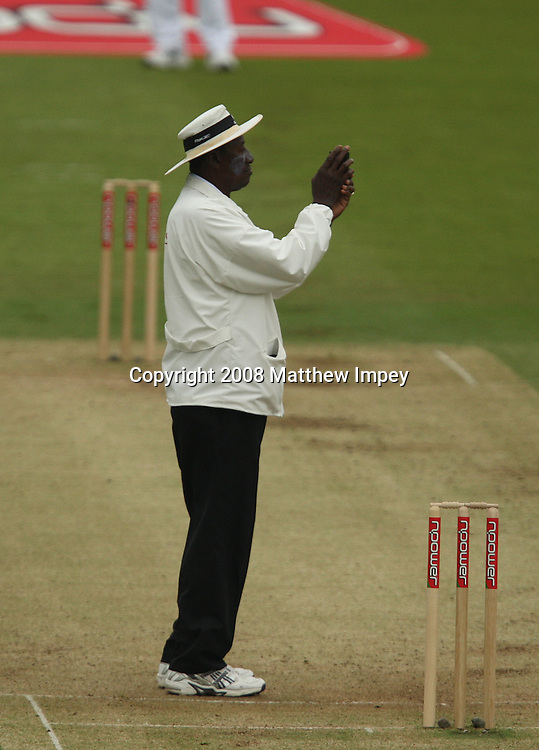 Umpire Steve Bucknor takes one of many light readings during the day. England v New Zealand, Day 2, 1st Npower Test, Lord's Cricket Ground, St.Johns Wood, London,15/05/2008. © Matthew Impey / Wiredphotos.co.uk. tel: 07789 130 347 e: matt@wiredphotos.co.uk