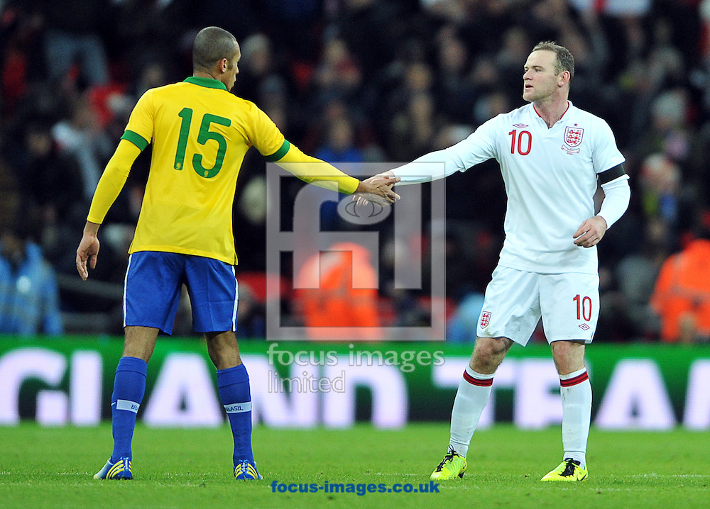 Picture by Daniel Hambury/Focus Images Ltd +44 7813 022858.06/02/2013.Wayne Rooney of England shakes hands with Miranda of Brazil after the Friendly match at Wembley Stadium, London.