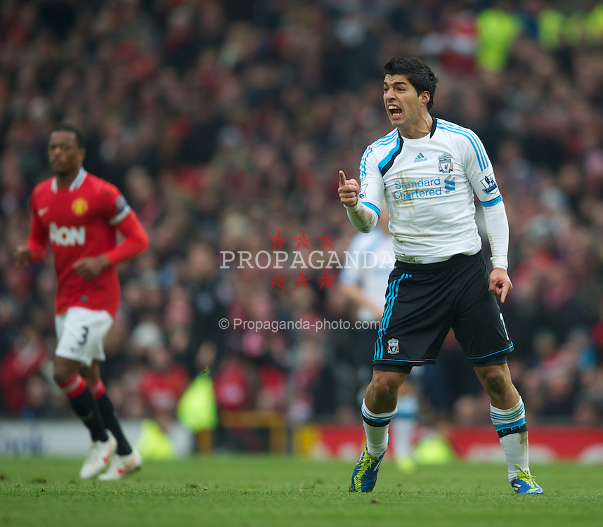 MANCHESTER, ENGLAND - Saturday, February 11, 2012: Liverpool's Luis Alberto Suarez Diaz can't believe he wasn't awarded a free-kick during the Premiership match against Manchester United at Old Trafford. (Pic by David Rawcliffe/Propaganda)