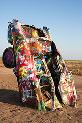 graffiti covered cadillac car at the Cadillac Ranch in Amarillo, Texas