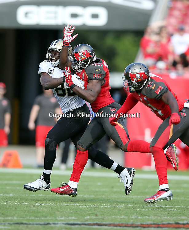 New Orleans Saints tight end Benjamin Watson (82) tries to catch a pass broken up by Tampa Bay Buccaneers linebacker Bruce Carter (50) and Tampa Bay Buccaneers strong safety Major Wright (31) during the 2015 week 14 regular season NFL football game against the Tampa Bay Buccaneers on Sunday, Dec. 13, 2015 in Tampa, Fla. The Saints won the game 24-17. (©Paul Anthony Spinelli)