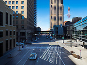 """13 MARCH 2020 - DES MOINES, IOWA: Downtown Des Moines is nearly deserted as many of employers are implementing work at home rules. The Governor of Iowa announced Friday that 17 people in Iowa have tested positive for the Novel Coronavirus. Of those, 15 people were exposed on the same cruise in Egypt, the others were exposed through travel but were not on the same cruise. The Governor said there has not yet been any """"community spread"""" in Iowa. All of the Iowans who have tested positive are in self quarantine. Across Iowa, municipalities and businesses are taking steps to implement """"social distancing."""" Most of the colleges in Iowa have announced that they will remain closed after their spring breaks and that classes will move to online only, after spring break. Many businesses in Des Moines, including Nationwide Insurance and EMC Insurance, have announced plans to have their employees to telecommute. The mayor of Des Moines has urged event planners to consider canceling large events.     PHOTO BY JACK KURTZ"""