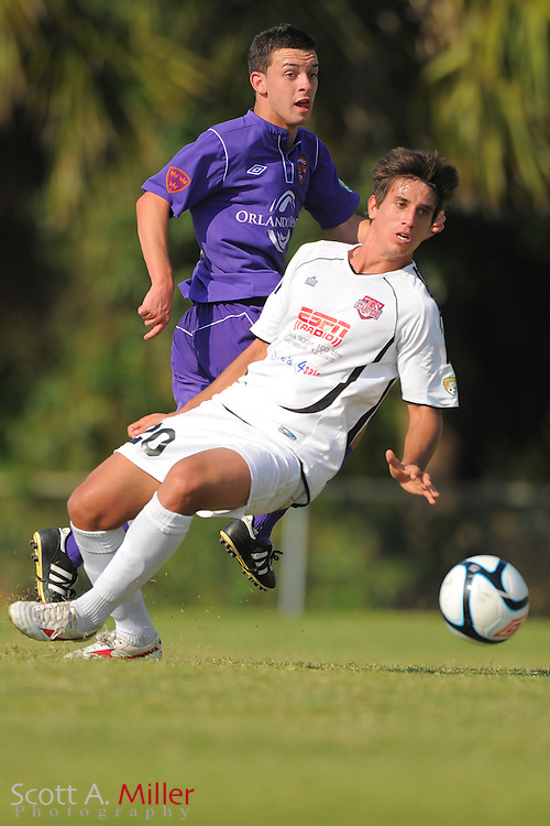 Orlando City U23s defender David Graydon (12) and Ocala Stampede forward Rhuan Penaforte (20) fight for a ball during their game at the Seminole Soccer Complex Saturday on May 26, 2012 in Sanford, Fla. ...©2012 Scott A. Miller..