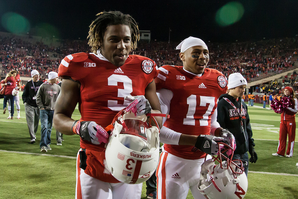 October 27, 2012: Daimion Stafford (3) of the Nebraska Cornhuskers and Stanley Jean-Baptiste (16) of the Nebraska Cornhuskers walk off the field after defeating the Michigan Wolverines 23 to 9 at Memorial Stadium in Lincoln, Nebraska. Photo by John S. Peterson