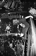 A teenage rock fan about to jump off a balcony into the crowd, Australia 2000's