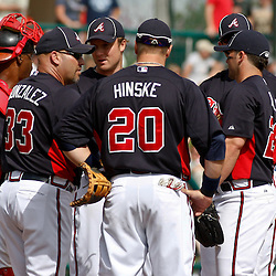March 5, 2011; Lake Buena Vista, FL, USA; Atlanta Braves manager Fredi Gonzalez (33) huddles with his players during a spring training exhibition game against the New York Mets at Disney Wide World of Sports complex.  Mandatory Credit: Derick E. Hingle