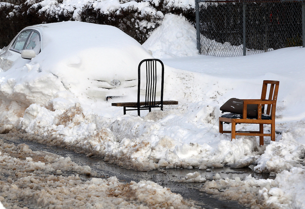 (Boston, MA - 1/28/15) Space savers mark barely-cleared spots in Dorchester, Wednesday, January 28, 2015. Staff photo by Angela Rowlings.