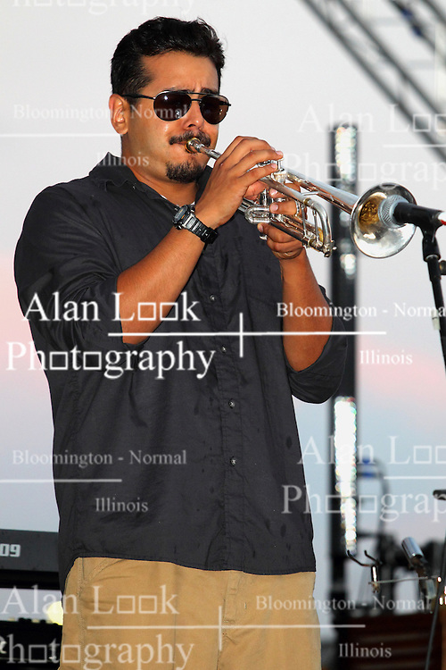 20 September 2014:   Aaron Garcia<br /> <br /> Marc Boon and the Unknown Legends perform at the Chris Brown Benefit Concert at the Corn Crib Stadium, Normal Illinois.  The band is comprised of 8 musicians: Marc Boon - front man and lead guitar, Jeff Young - drums, Ray Wiggs- keyboards, Aaron Garcia - trumpet-percussion-vocals, Burl Torner - guitar, Russell Zehr - saxaphone-guitar-keyboards-vocals, Chris Briggs - bass-vocals-keyboard, Jerry Abner - keyboards,