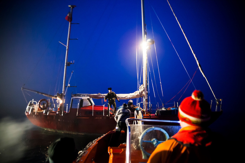 Krzysztof Rozanski, captain of the Eltanin, welcomes a zodiac of Polish researchers coming aboard out in the Greenland Sea, off the coast of Spitsbergen, Svalbard. The yacht sails from Poland to Svalbard every summer to provide transportation to researchers and tourists.