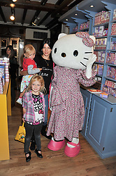 LIBERTY ROSS with her daughter SKYLA SAUNDERS (standing) and niece DOMINO ROSS at a Hello Kitty Event at Liberty to lauch their collection of Hello Kitty products at Liberty, Great Marlborough Street, London on 25th September 2011.