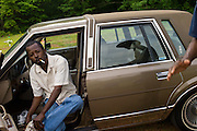 """BESSEMER, AL – APRIL 27, 2012: Blues legend Henry """"Gip"""" Gipson (right), tends to the graveyard he owns outside of Bessemer with a relativ. <br /> <br /> After an altercation with the KKK in the 60's rendered his left hand badly broken, Gipson's method of guitar playing had to change. """"I had to crowd the strings,"""" Gipson said, describing the method that he adopted. Today, Gipson operates Gip's Place, one of few true remaining juke joints in the country. """"Music don't care no color,"""" Gipson said. """"And that's why I love blues, because blues deals with a story to tell you."""""""