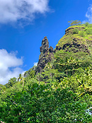 Stone formation that looks like Easter Island Moai, Omoa, Fatu Hiva, Marquesas, French Polynesia, South Pacific
