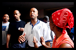 31st August, 2005. Mayor Ray Nagin takes some heat from an angry refugee trapped at the Hyatt Hotel in New Orleans as he vents his frustrattion against the Govenor and the President.