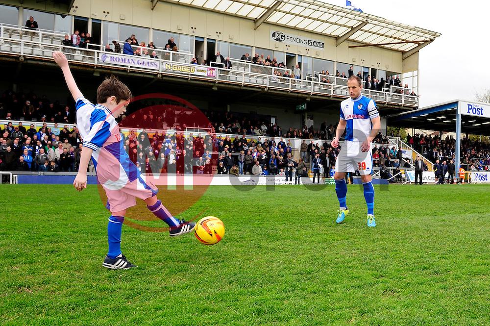 mascot plays football with Bristol Rovers' Mark McChrystal  - Photo mandatory by-line: Dougie Allward/JMP - Mobile: 07966 386802 12/04/2014 - SPORT - FOOTBALL - Bristol - Memorial Stadium - Bristol Rovers v Torquay United - Sky Bet League Two