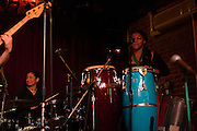 Dec. 6, 2013 - Brooklyn, NY. Rosa Avila (l.) plays the drums and Paula Green (r.) plays percussion with dawn drake & ZapOte at the Audiofiles live show in the Jalopy Theatre.  12/6/13 Photograph by Julius C. Motal/CUNY Journalism PHOTO