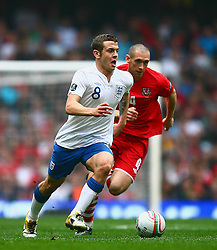26.03.2011, Millenium Stadium, Cardiff, ENG, EURO 2012 Qualifikation, England vs Wales, im Bild Action with Jack Wilshere of England  and Andrew Crofts  of Wales    during Wales vs England at the Millenium Stadium in Cardiff for the Euro 2012 qualification, group G  on 26/03/2011. EXPA Pictures © 2011, PhotoCredit: EXPA/ IPS/ Marcello Pozzetti +++++ ATTENTION - OUT OF ENGLAND/UK and FRANCE/FR +++++