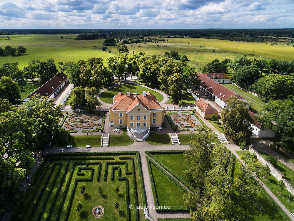 Palmse manor house in Estonia. Aerial view, old castle. Flower garden and pathway, park.