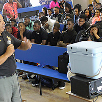 Aberdeen School Resource Officer Chris Dobbins talks to Belle-Shivers Middle School eighth-graders Friday about the dangers of bullying.