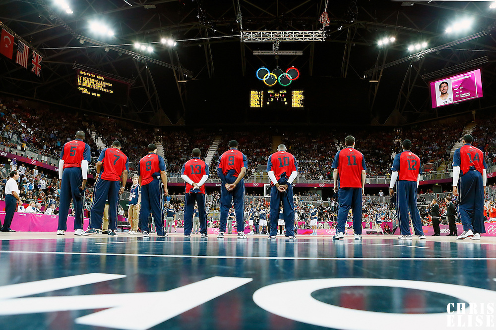 06 August 2012: Team USA is seen during the National Anthem prior to the 126-97 Team USA victory over Team Argentina, during the men's basketball preliminary, at the Basketball Arena, in London, Great Britain.