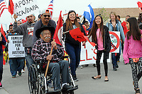 """With cries of """"Si Se Puede"""" ringing out in a sea of red United Farm Worker flags, hundreds of people joined forces in east Salinas on Sunday morning to help rejuvenate the annual march honoring labor leader César Chávez."""