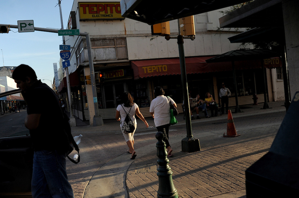 Mexican tourists and workers cross into the center of Laredo, Texas on August 19, 2010 in the early morning. City officials say negative attitudes about the city's more dangerous sister Nuevo Laredo have kept tourists from coming and effected the over all economics of the town. Laredo also depends heavily on tourism from Mexico, as people from northern Mexico come to the border city to make purchases on merchandise like designer clothes that they cannot find cheaply in their country, but since Mexico's border region has become increasingly violent, store owners in Laredo, Texas say Mexican shoppers are staying home.