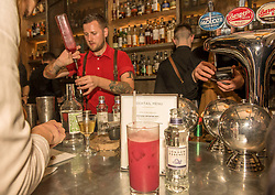 The world's best bartender, Jack McGarry, from New York (where he runs The Dead Rabbit bar, the best bar in the world 2016 ) is serving cocktails in Edinburgh this week. Here he is working in Devils Advocate just off the Royal Mile. All part of a five day Tales of the Cocktail event taking place in numerous venues across the city this week. Pictured: Jack McGarry<br /> <br /> <br /> © Jon Davey/ EEm