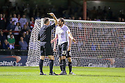 Rory McArdle receives a caution leading to Yorks second goal during the Capital One Cup match between York City and Bradford City at Bootham Crescent, York, England on 11 August 2015. Photo by Simon Davies.