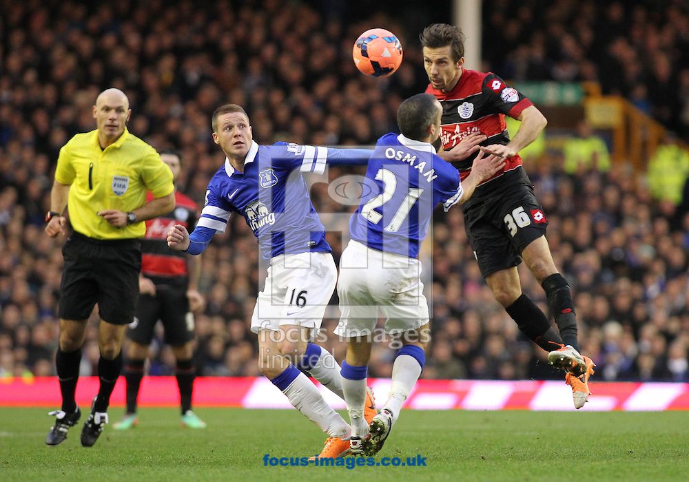 Picture by Michael Sedgwick/Focus Images Ltd +44 7900 363072<br /> 04/01/2014<br /> Leon Osman of Everton and Gary O'Neil of Queens Park Rangers in action during the FA Cup match at Goodison Park, Liverpool.
