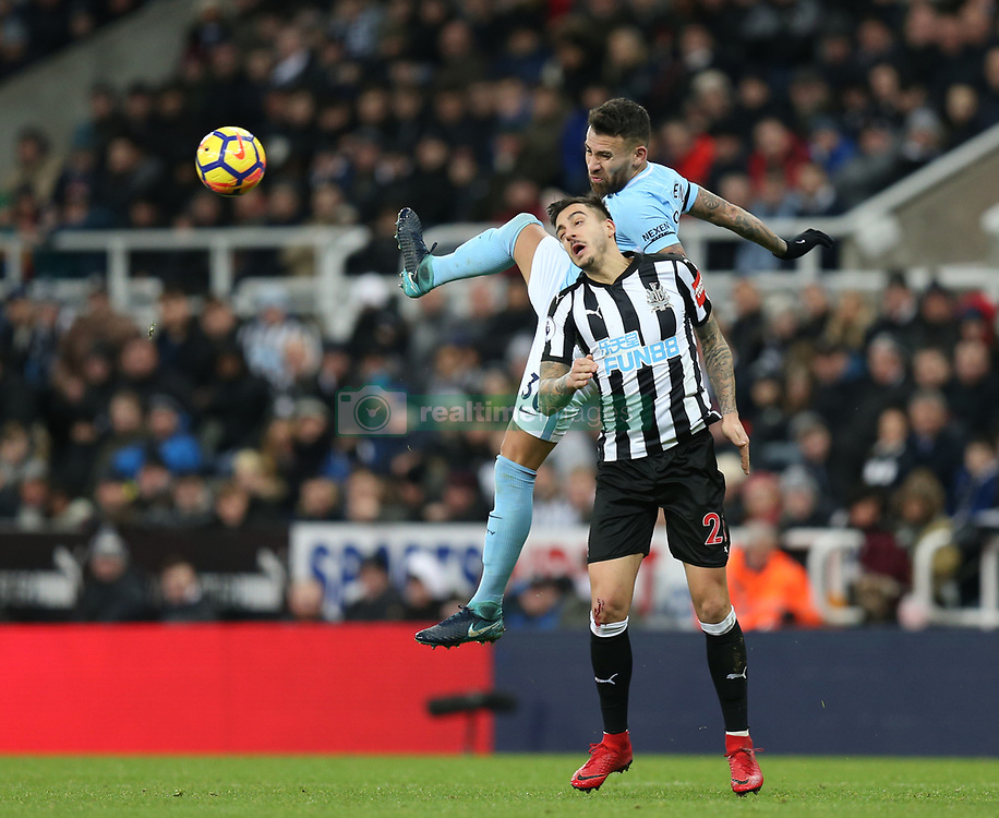 27 December 2017 Newcastle: Premier League Football - Newcastle United v Manchester City : Nicolas Otamendi of Man City wins a heading duel with Joselu Mato Sanmartin of Newcastle.<br /> (photo by Mark Leech)