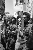 Kathleen Cleaver with Peco (on her right) and Emory Douglas (minister of culture) in Oakland California at  Black Panther Rally for releasing Huey Newton from prison 1969