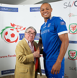 CARDIFF, WALES - Tuesday, August 14, 2012: Port Talbot Town's Cortez Belle with Ronnie Corbett, the sporting ambassador ot Corbett Sport, at the launch the 2012/2013 Welsh Premier League at the St. David's Hotel. (Pic by David Rawcliffe/Propaganda)