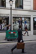Passers-by outside the gentleman's outfitter Charles Tyrwhitt on Jermyn Street, on 5th March 2018, in London, England.