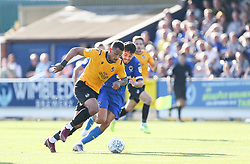 Jonson Clarke-Harris of Bristol Rovers runs past Will Nightingale of AFC Wimbledon - Mandatory by-line: Arron Gent/JMP - 21/09/2019 - FOOTBALL - Cherry Red Records Stadium - Kingston upon Thames, England - AFC Wimbledon v Bristol Rovers - Sky Bet League One