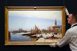 "© Licensed to London News Pictures. 02/06/2017. London, UK. A technician presents ""View of Venice with Santa Maria della Saulte in the background"", by Alexei Bogoliubov. (Est. 250-300k).  Preview of Sotheby's sale of Russian pictures and works of art which takes place on 6 June 2017 at Sotheby's in New Bond Street. Photo credit : Stephen Chung/LNP"