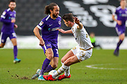 Portsmouth midfielder Marcus Harness (19) is challenged by Milton Keynes Dons midfielder Jordan Houghton (24) during the EFL Sky Bet League 1 match between Milton Keynes Dons and Portsmouth at Stadium MK, Milton Keynes, England on 29 December 2019.