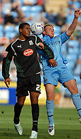 Photo: Ed Godden.<br />Coventry City v Plymouth Argyle. Coca Cola Championship. 30/09/2006. Chris Birchall (R) and Plymouth's Reuben Reid clash in the air.