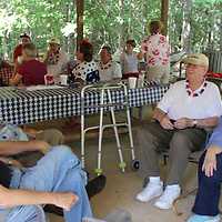 RAY VAN DUSEN/BUY AT PHOTOS.MONROECOUNTYJOURNAL.COM<br /> Retirees gathered at Blue Bluff for their annual Fourth of July picnic sponsored by the Aberdeen Visitors Bureau. Nearly 40 people enjoyed a barbecue meal complimented with sides and desserts they brought.